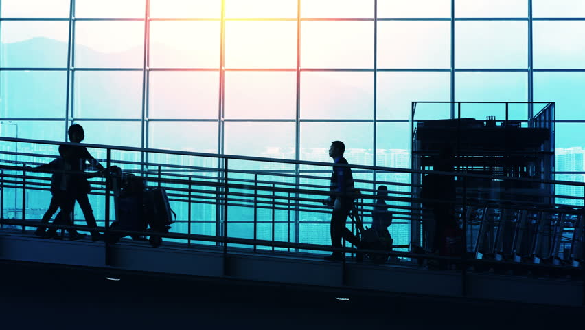 Sunset airport terminal hall. Walking travelers silhouettes. | Shutterstock HD Video #9801497