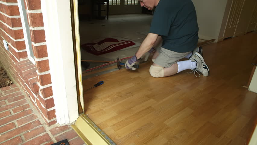 Removing Laminate Flooring best way to remove linoleum flooring concrete youtube A Workman Or Homeowner Handyman Type Engaged In A Diy Project Of Removing Old Laminate Flooring