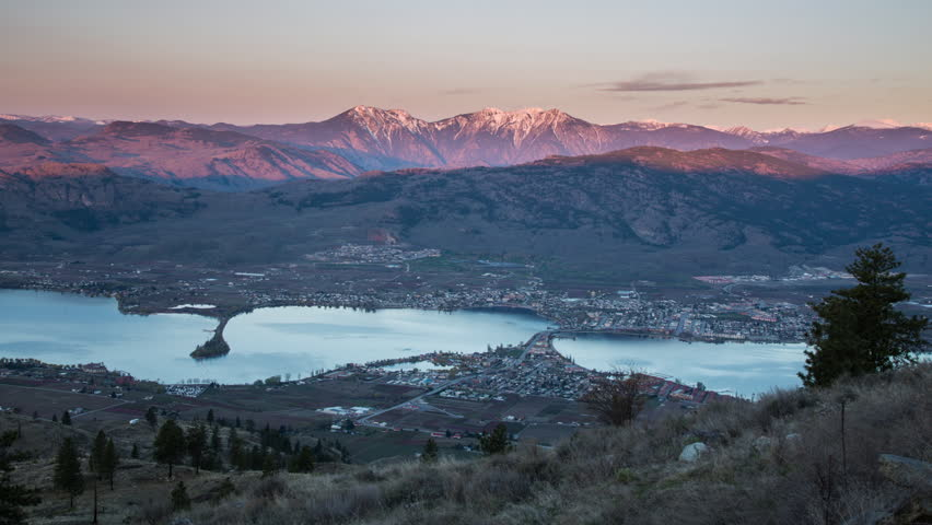 Morning sunrise lights shining on mountains in north cascade in distance. Above Osoyoos in British Columbia, Canada with Osoyoos Lake below