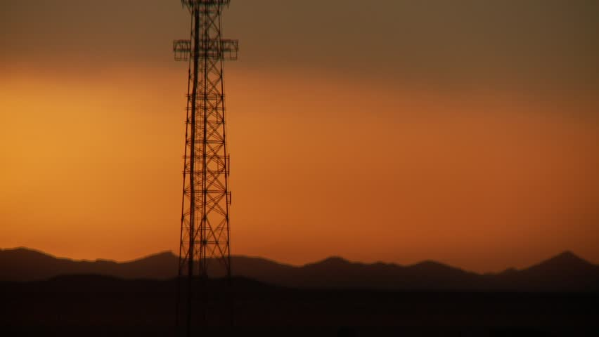 Video footage of a cell tower in the sunset in Bolivia - HD stock footage clip