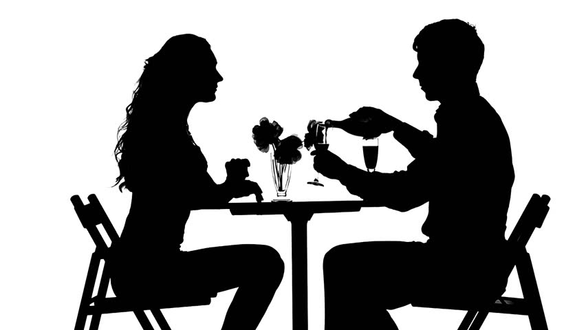 Silhouettes Of Man And Woman Drinking Wine Sits At Table