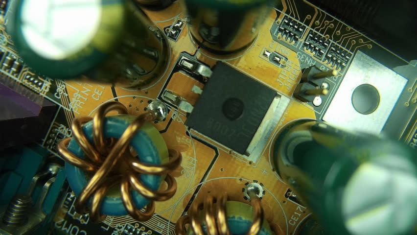 The components of the computer motherboard. The camera moves over the processor. Circuit works inside the chip. Closeup. Dolly shot