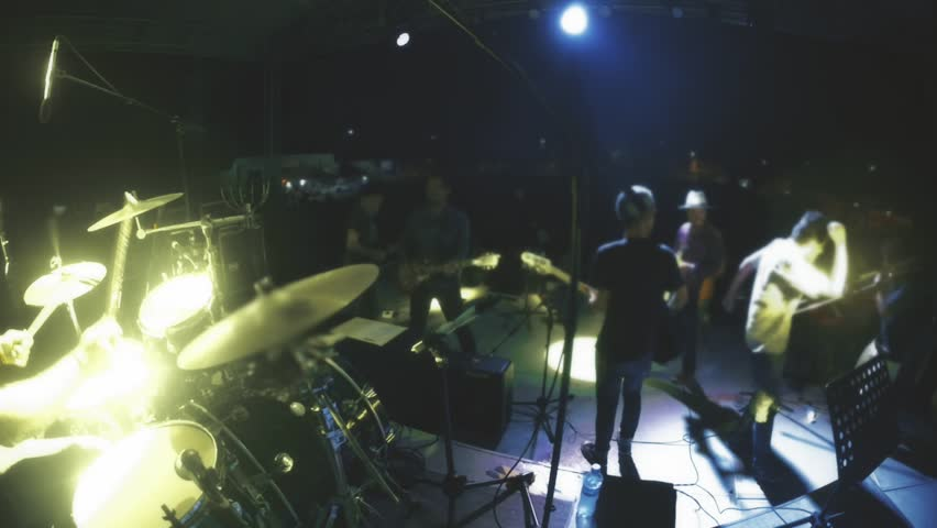 Rock Band Having Fun In Stage On A Live Performance. Slow ... - photo#42