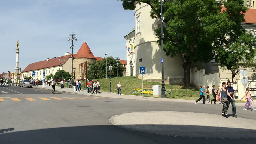 ZAGREB, CROATIA - MAY 13, 2015: Group of children walking down from Kaptol on a bright, sunny day | Shutterstock HD Video #9975971