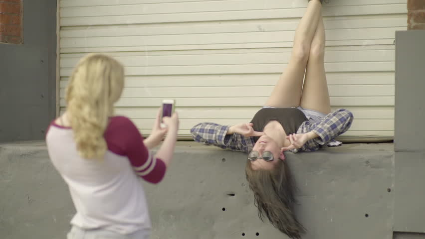 Teen Takes Photos Of Her Mixed Race Friend, Hanging Upside Down On A Loading Dock (Slow Motion)
