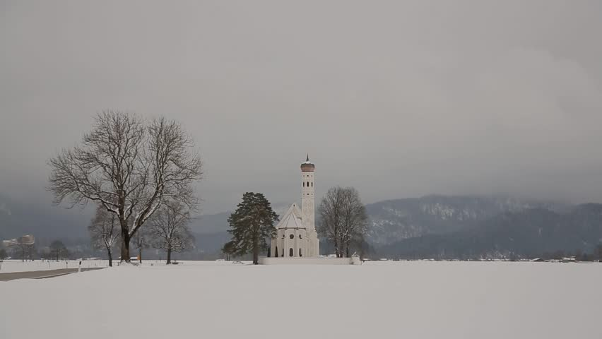 video footage of the Church St. Coloman in misty winter landscape, Schwangau, Germany - HD stock video clip